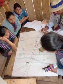 Guatemalan women working on a project map