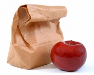 image of brown bag lunch with apple