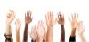 hands raised to vote