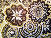 Sample doodle made using black paper with white and gold pens