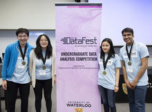 Students posing around datafest sign