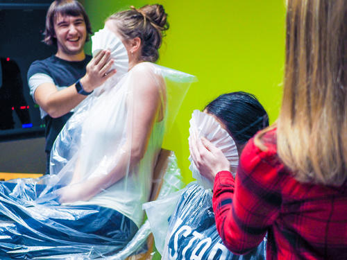 two girls getting pied in the face