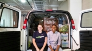 Elle Crevits and her partner with a van of food