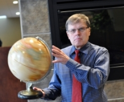 Larry Smith spins a globe