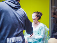 girl laughing after being pied in the face