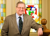 Lloyd Axworthy with stained glass background