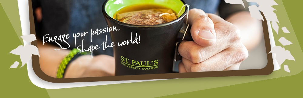Student holding St. Paul's mug with Fair Trade tea in it
