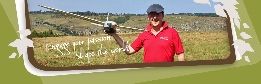 Patrick Meier with a drone in a field in Tanzania