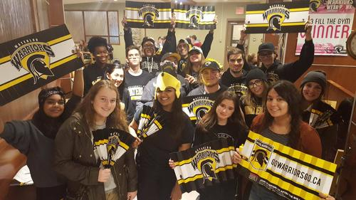 group of St. Paul's students showing spirit, about to go to Warriors game