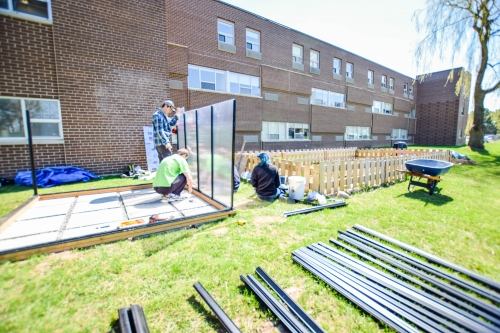 Students building green house outside St. Paul's