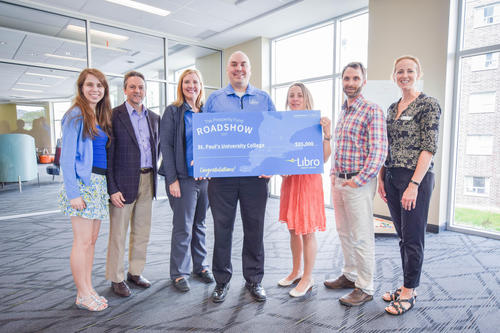 Group of Libro and GreenHouse employees holding giant cheque