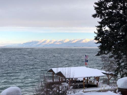 Flathead Lake in winter with snowcapped mountains in background