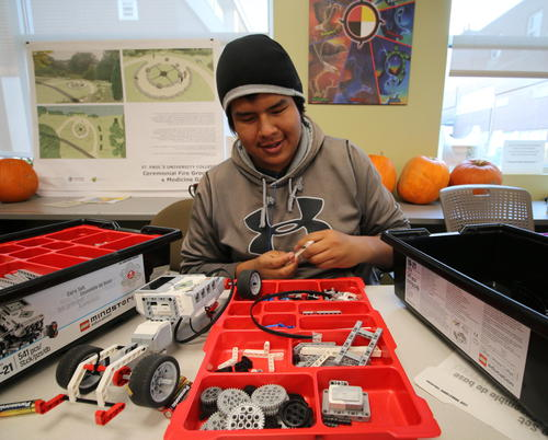 Indigenous student building robot