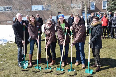 staff and students making first dig at new building