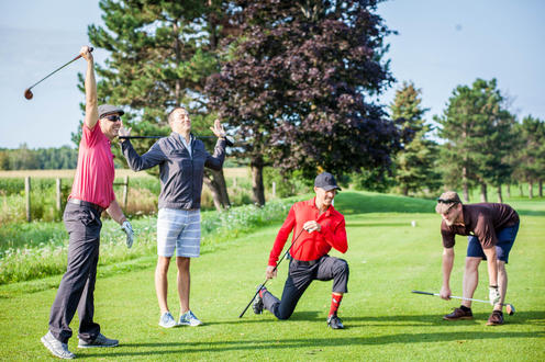 group of golfers stretching