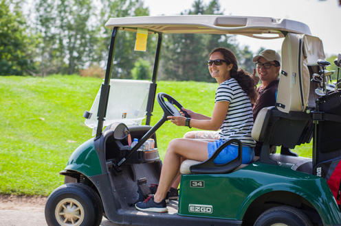 two golfers on their cart