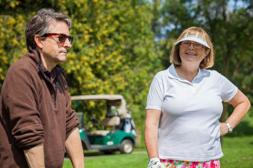 Principal Myers chats with golfer Jeanne