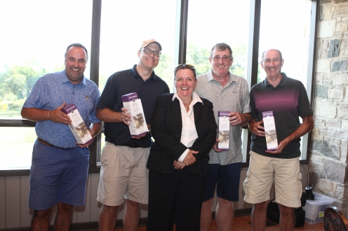 winners of par 3 poker pose with group prize and sponsor representative