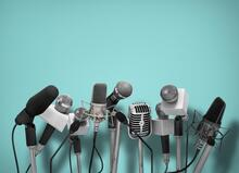 several microphones lined up beside each other