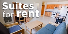 suites for rent text overlaying image of grad apartment living room