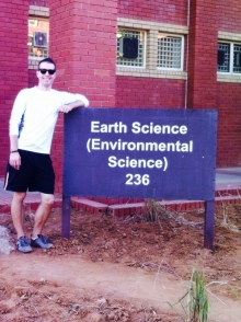 Tomm in front of an Earth Sciences building