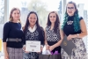 Group of 4 women, 3 are Indigenous students accepting the award