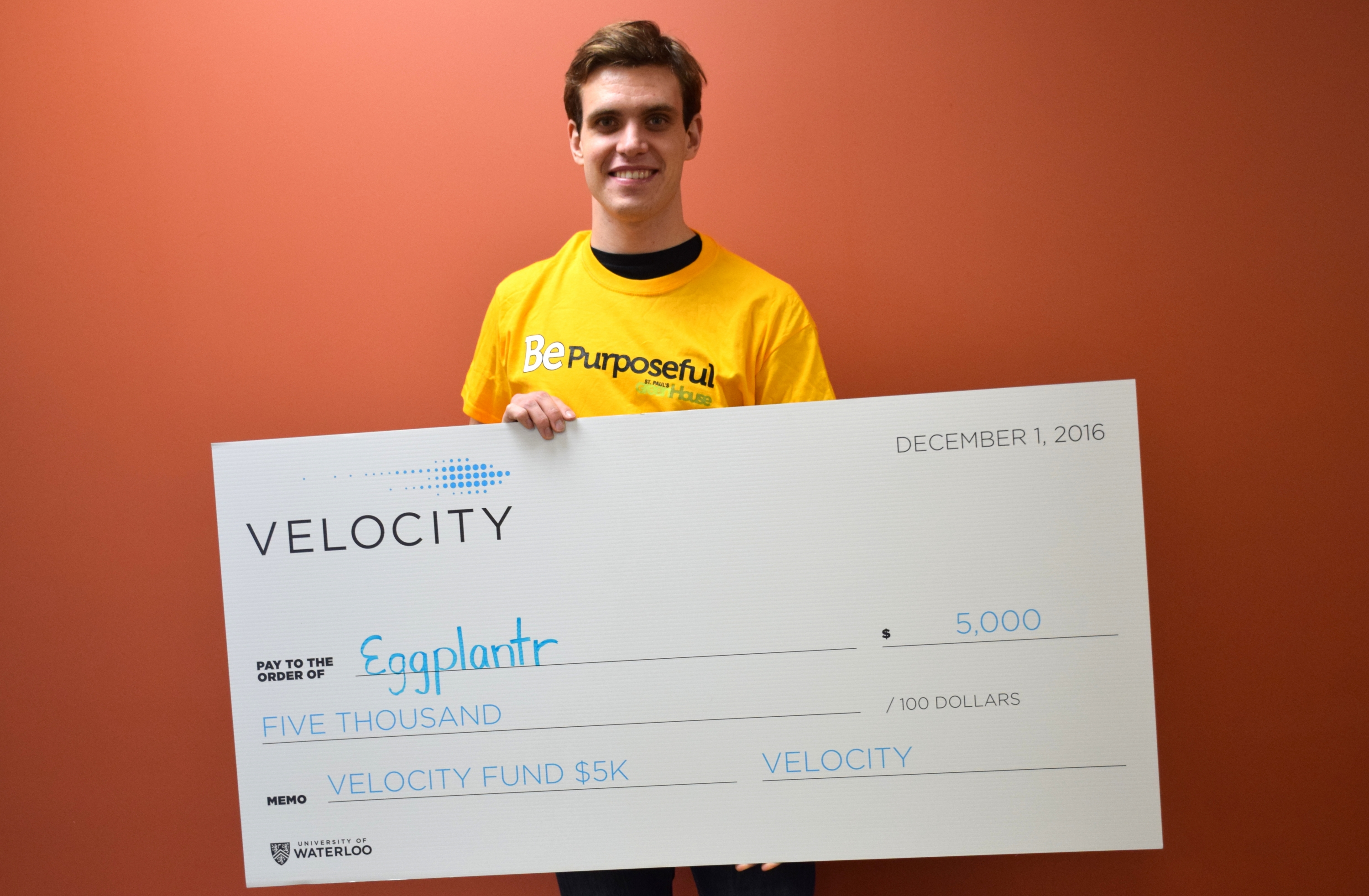 Michael Wideman with Velocity mock cheque