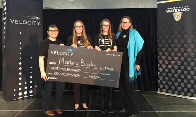 Marlena Books team accepting cheque