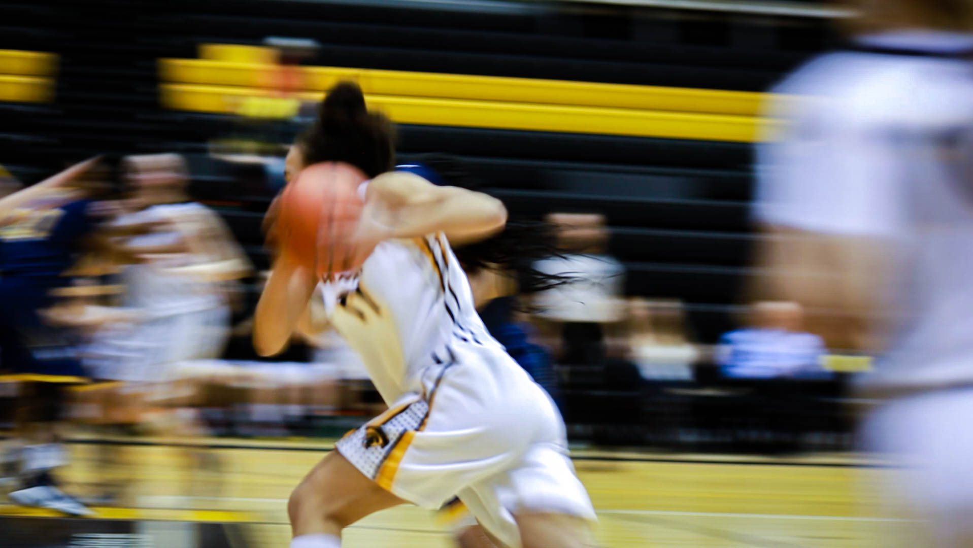 motion blurred image of girl playing basketball