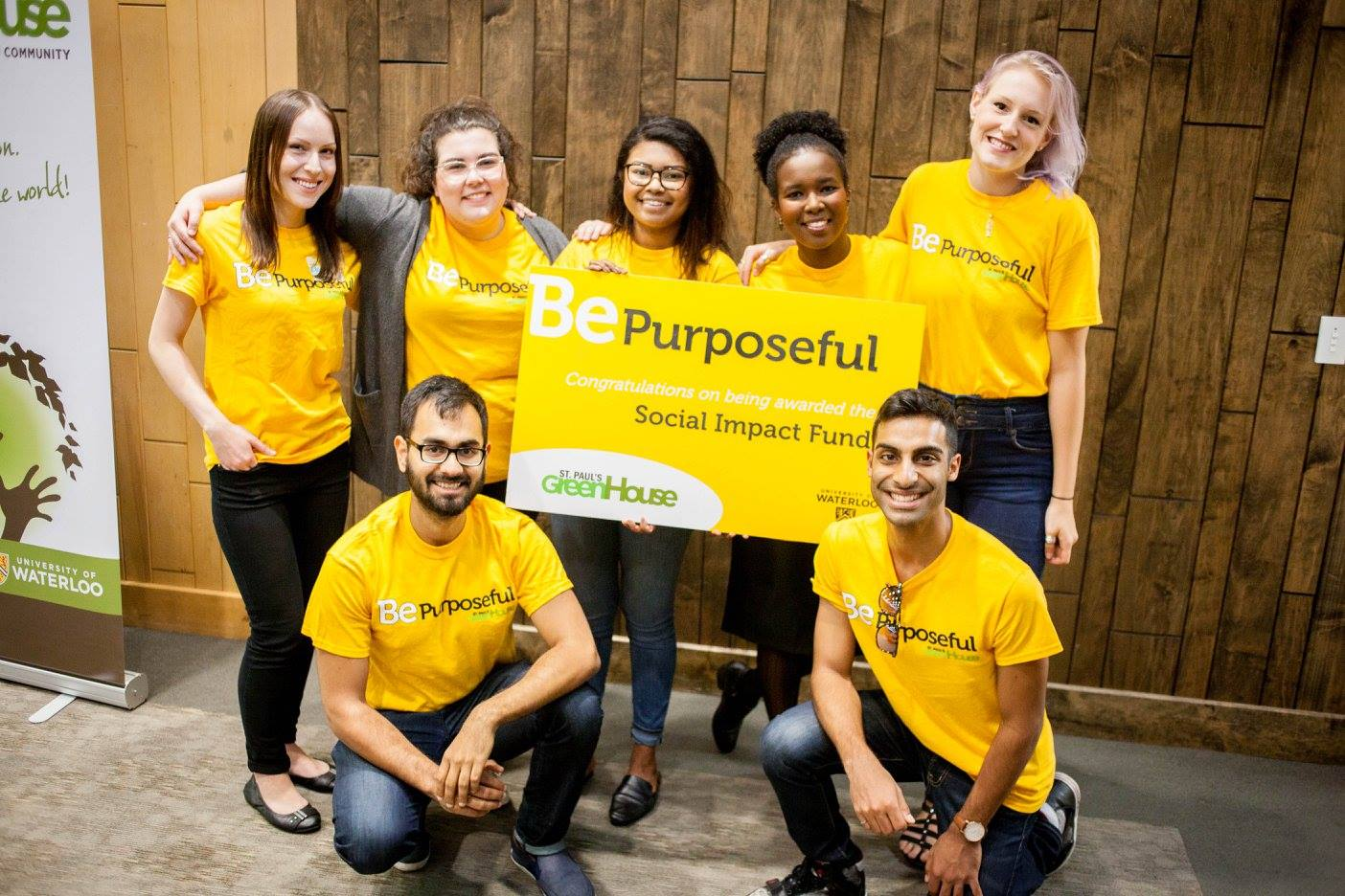 Social Impact Fund recipients hold up a banner