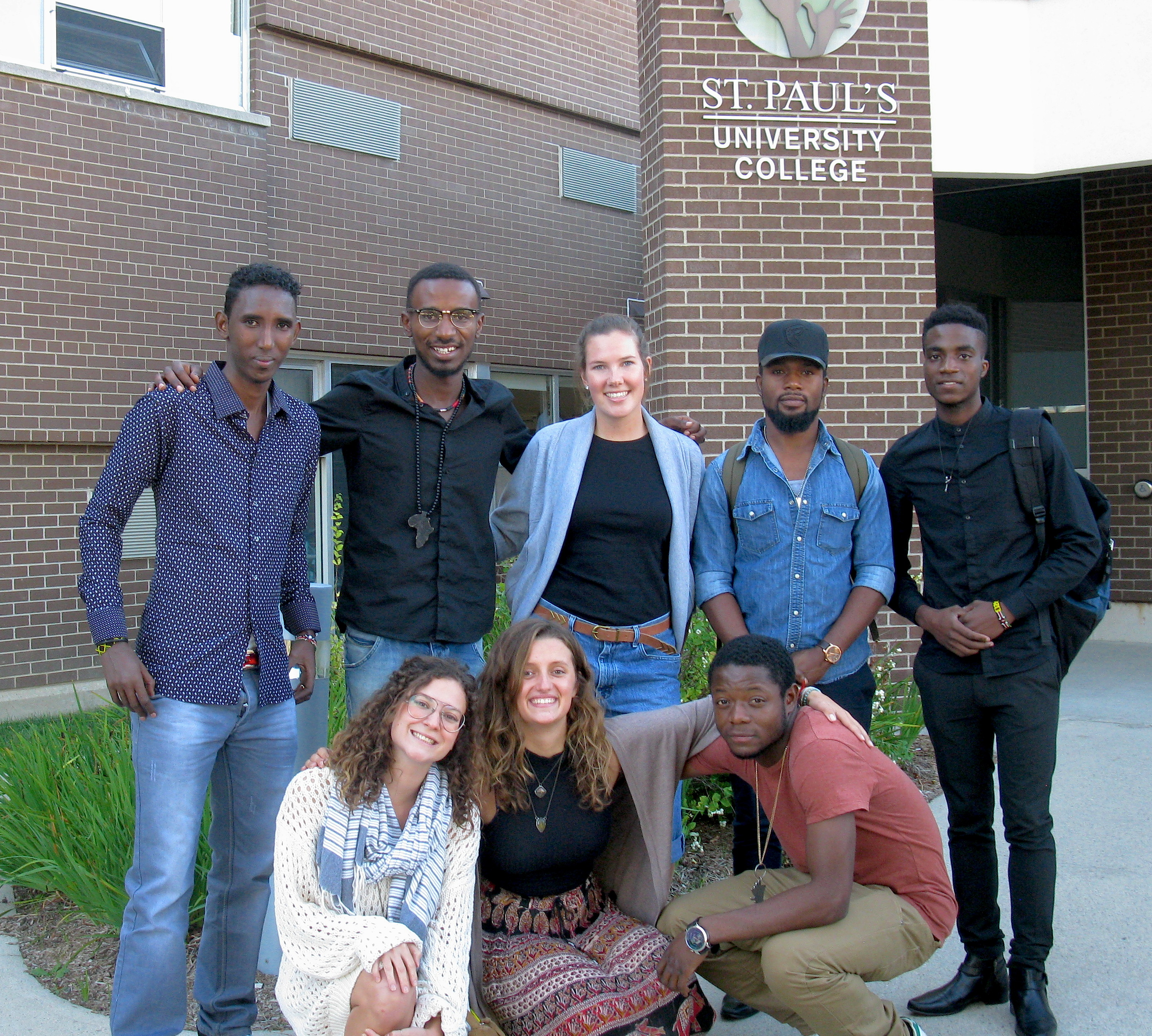 Members of the local WUSC committee and the 2 new students