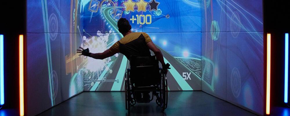 Person in wheelchair using exercube