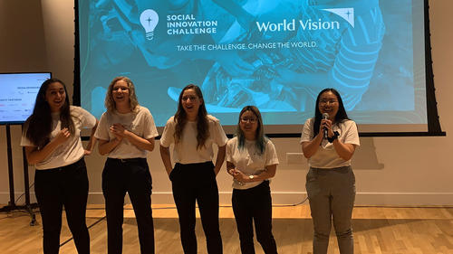 Virtuous Waste team smiling and laughing as the winners of the World Vison Social Innovation Challenge are announced.
