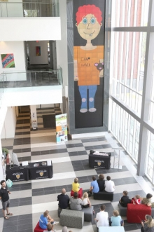Students who participated in the Code-a-Character program showcased their digital creations on the university's MicroTiles wall.