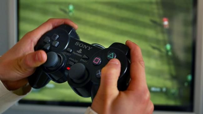 Hands with video game controller
