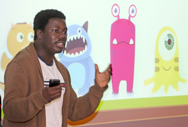 GBDA student Seyitan Oke presents his team's LaMonsters Club game concept at the University of Waterloo Stratford campus.