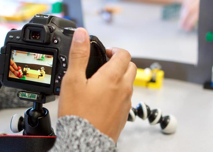 Student with a camera and stand