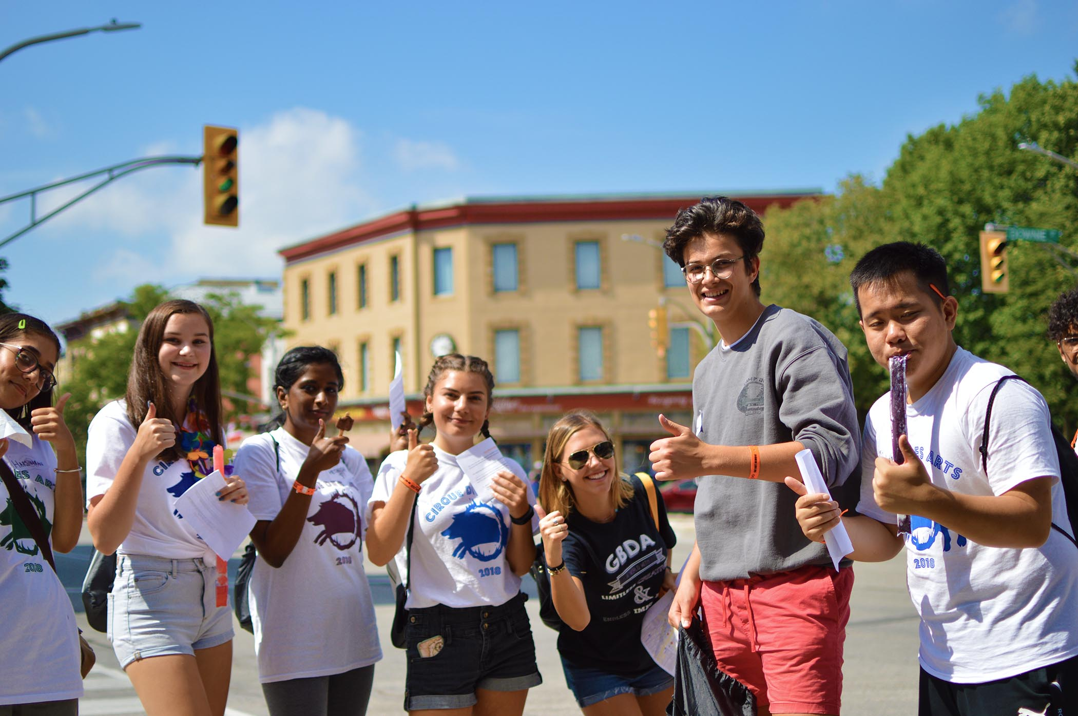 New students giving thumbs-up downtown Stratford
