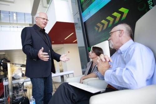 Host Peter Mansbridge chats with panelists Christine McWebb and Ken Roberts.