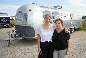 Tara Cooper and Denise St. Marie in front of the airstream
