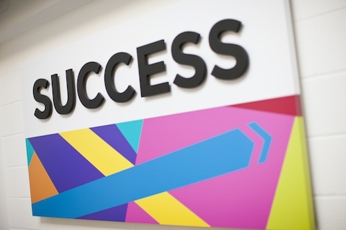 A sign board that says success