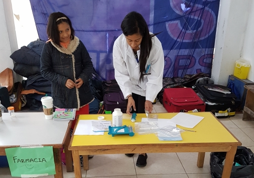 Heidi Fernandes administering medication to a patient