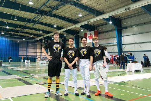 A group photo of the fencing team. From left to right, Ryan, Caleb, Marc, and Gareth