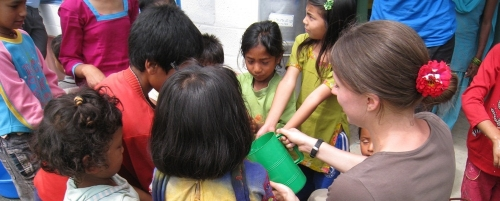 Children gather to wash their hands.