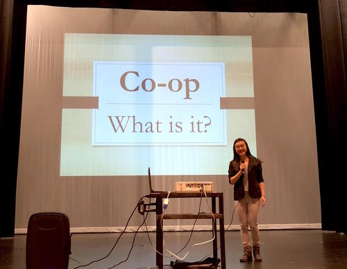 Cindy Wei presnting a powerpoint about Co-op
