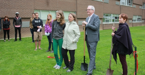 Lexi Salt stands infront her new community garden with St. Paul's staff and faculty who supported her project.