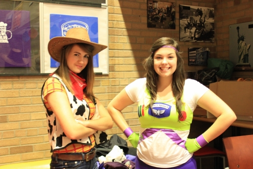 Two students in costume as Woody and Buzz Lightyear from Toy Story.