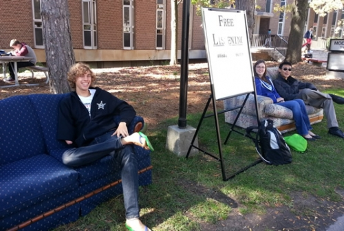 "Students speaking to ""Listeners"" on Ryan Mann & Ryan Martens Listening Couches outside Modern Languages."