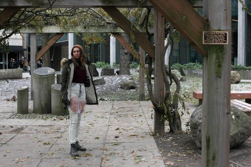 Kara standing in Peter Russell Rock Garden in Nadine Simec's butterfly design
