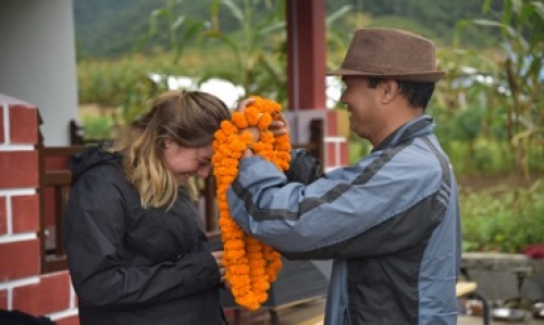 Courtney Lang in Nepal receives a necklace from a local.